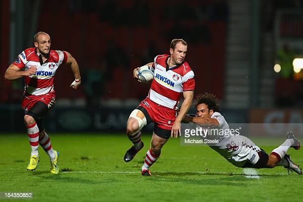 James Simpson-Daniel of Gloucester evades the challenge of Thierry Brana of Bordeaux-Begles as Charlie Sharples waits in support during the Amlin...
