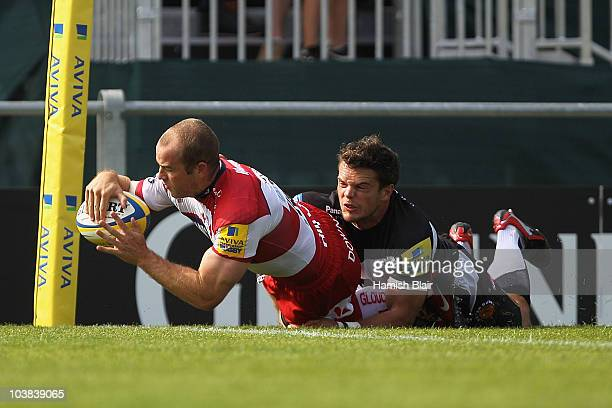 James SimpsonDaniel of Gloucester scores his team's first try under pressure from Mark Foster of Exeter during the AVIVA Premiership match between...