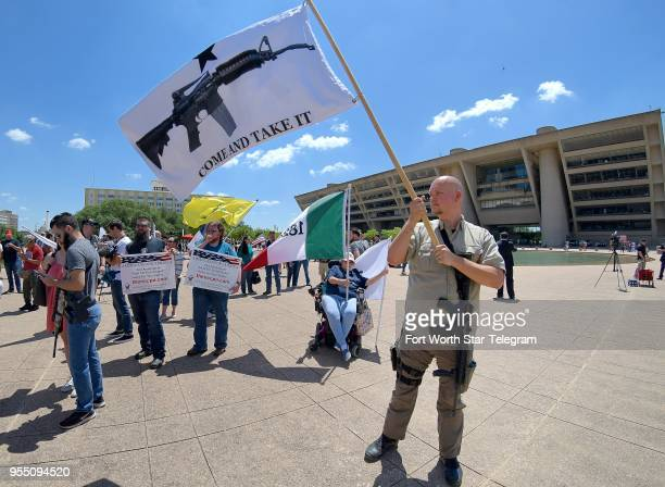James Singer of Pleasanton Texas flies a Come and Take It flag along his AR15 and Walther PPQ firearms at a Second Amendment rally at City Hall in...