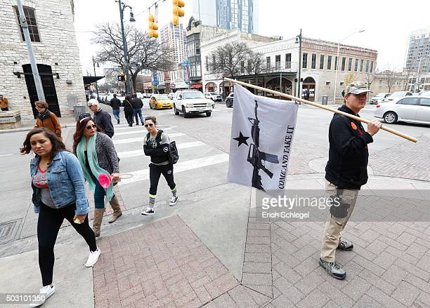 James Singer of south Texas takes part in a public walk around downtown Austin after an open carry gun rally On January 1 the open carry law takes...