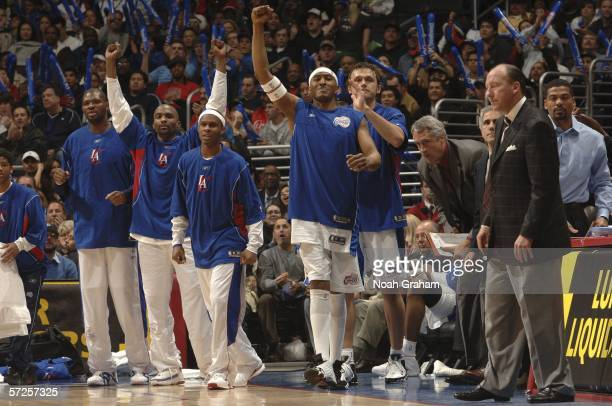 James Singleton Walter McCarty Cuttino Mobley Daniel Ewing Zeljko Rebraca and Head Coach Mike Dunleavy of the Los Angeles Clippers celebrate after a...