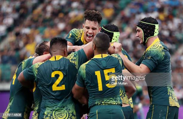 James Slipper of Australia is congratulated by his team mates after scoring his side's sixth try during the Rugby World Cup 2019 Group D game between...