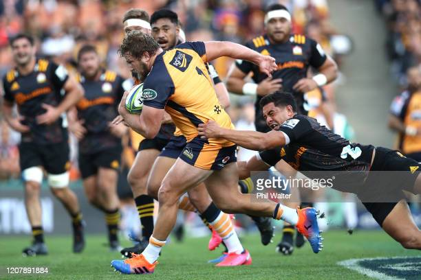 James Slipper of the Brumbies is tackled by Anton Lienert-Brown of the Chiefs during the round four Super Rugby match between the Chiefs and the...