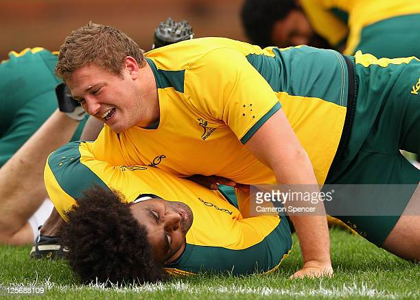 James Slipper of the Wallabies wrestles with team mate Radike Samo during an Australian Wallabies IRB Rugby World Cup 2011 training session at Rugby...