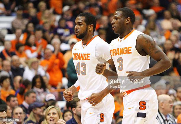 James Southerland and Dion Waiters of the Syracuse Orange run off the court during the game against the Albany Great Danes during the NIT Season...