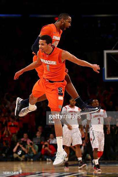 James Southerland and Michael CarterWilliams of the Syracuse Orange celebrate a play in the second half against the Louisville Cardinals during the...