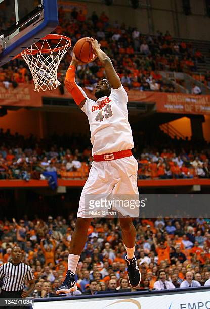 James Southerland of the Syracuse Orange dunks the ball against the Eastern Michigan Eagles during the game at the Carrier Dome on November 29 2011...
