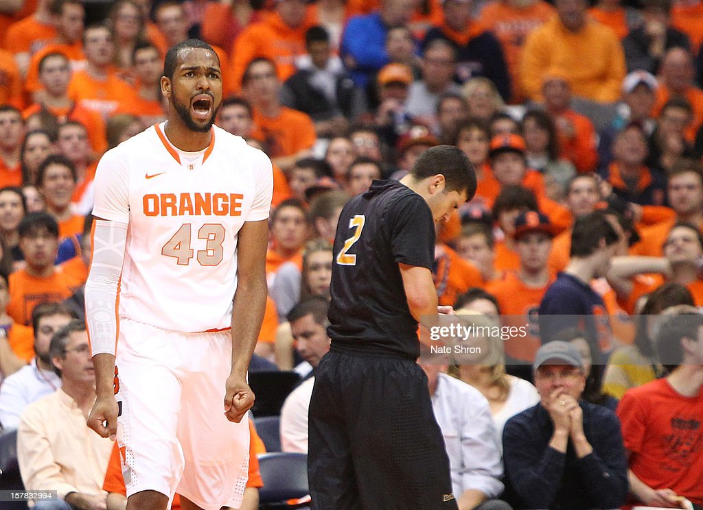 James Southerland #43 of the Syracuse Orange reacts after a play against Peter Pappageorge #2 of the Long Beach State 49ers during the game at the Carrier Dome on December 6, 2012 in Syracuse, New York.