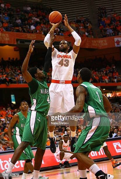 James Southerland of the Syracuse Orange shoots the ball while being defended by Jamir Hanner and Dennis Tinnon of the Marshall Thundering Herd...