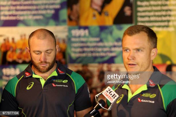James Stannard listens to Australia's Mens Sevens coach Tim Walsh speak to the media during a press conference at Rugby Australia HQ on June 18 2018...
