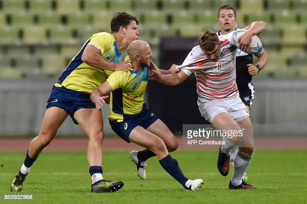 James Stannard of Austraile tackles George Chatterton of England during the match England vs Australia at the Rugby Oktoberfest7s in Munich southern...