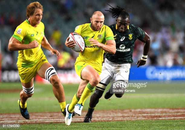 James Stannard of Australia breaks away from the defence in the MenÕs final match against South Africa during day three of the 2018 Sydney Sevens at...