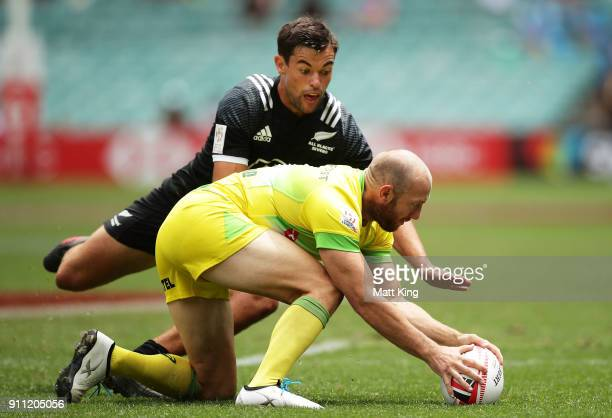James Stannard of Australia is challenged by Andrew Knewstubb of New Zealand in the quarter final match during day three of the 2018 Sydney Sevens at...