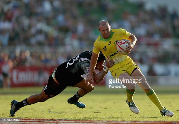 James Stannard of Australia is tackled by Sione Molia of New Zealand during day three of the Emirates Dubai Rugby Sevens HSBC World Sevens Series on...