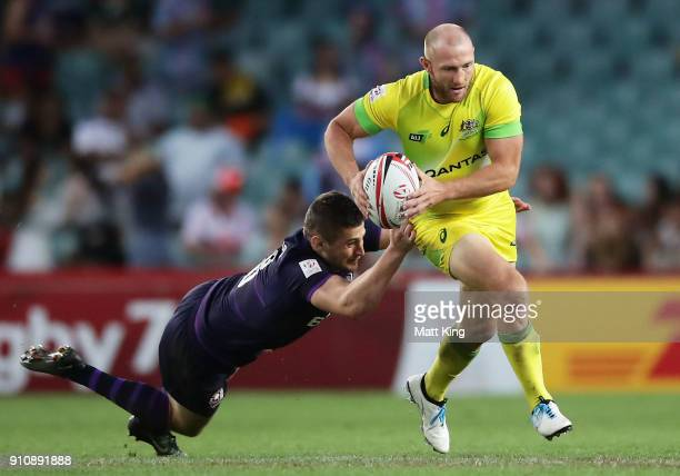 James Stannard of Australia is tackled in the game against Scotland during day two of the 2018 Sydney Sevens at Allianz Stadium on January 27 2018 in...