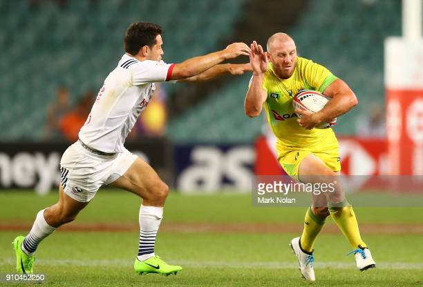 James Stannard of Australia is tackled in the mens pool match between Australia and the USA during day one of the 2018 Sydney Sevens at Allianz...