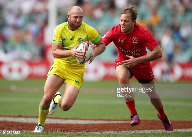 James Stannard of Australia runs away for a try in the game against Canada during day two of the 2018 Sydney Sevens at Allianz Stadium on January 27...