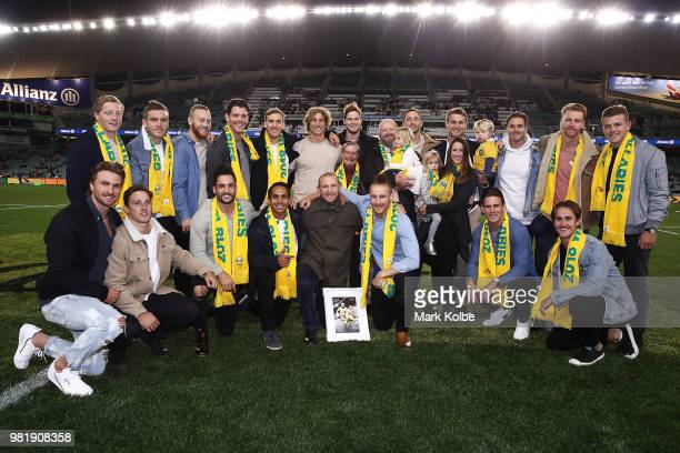 James Stannard poses with his family and the Australia Sevens team during a presentation after his retirement from the Australian Sevens team before...