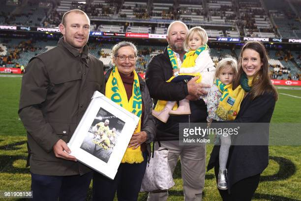 James Stannard poses with his family during a presentation after his retirement from the Australian Sevens team before the Third International Test...
