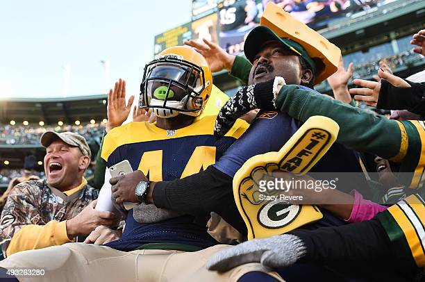 James Starks of the Green Bay Packers does the Lambeau Leap after scoring a touchdown in the first quarter against the San Diego Chargers at Lambeau...