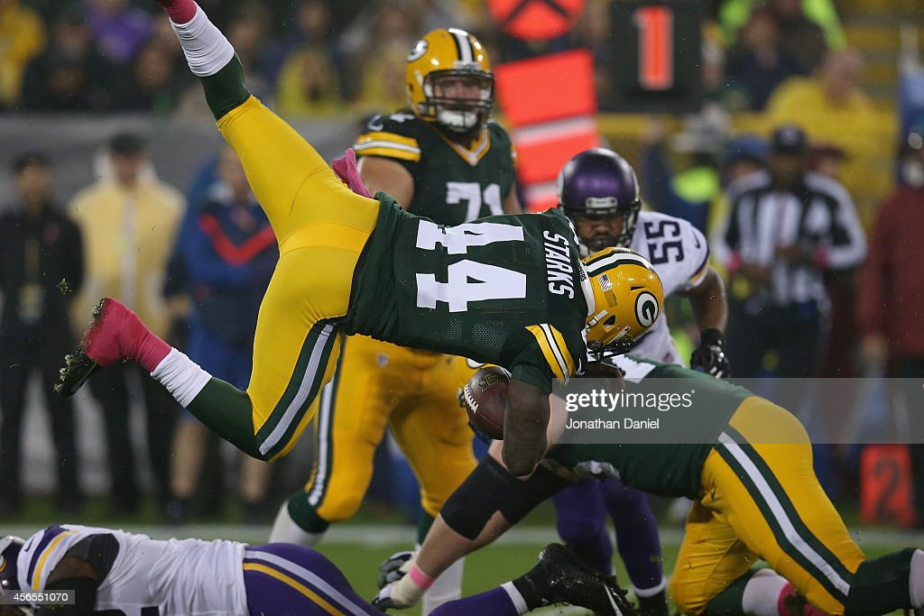 James Starks #44 of the Green Bay Packers flys through the air on a 3 yard play against the Minnesota Vikings in the first quarter at Lambeau Field on October 2, 2014 in Green Bay, Wisconsin.