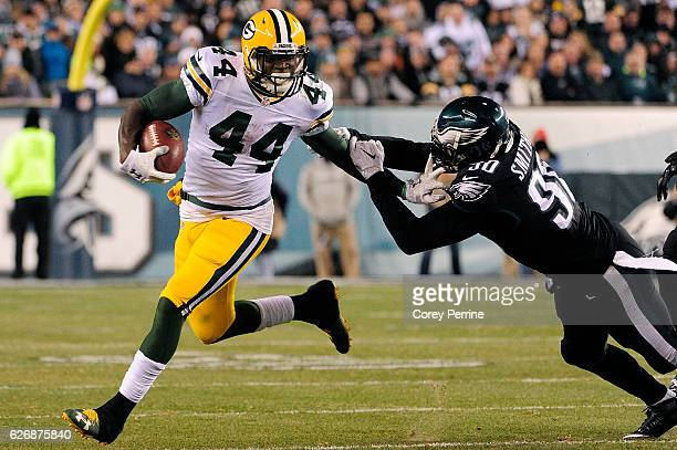 James Starks of the Green Bay Packers outpaces Marcus Smith of the Philadelphia Eagles in the third quarter at Lincoln Financial Field on November 28...
