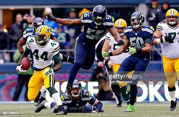 James Starks of the Green Bay Packers runs the ball as Earl Thomas Cliff Avril and KJ Wright of the Seattle Seahawks give chase during the second...