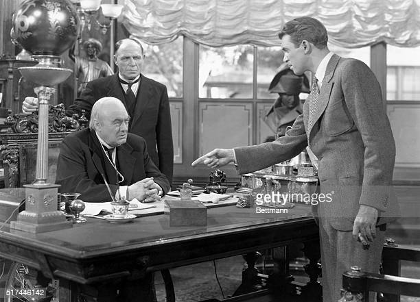James Stewart as George Bailey points at Lionel Barrymore in a scene from It's a Wonderful Life