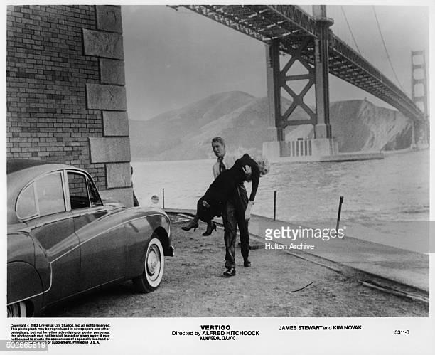 """James Stewart carries Kim Novak in a scene from the Universal movie """"Vertigo"""" circa 1956."""