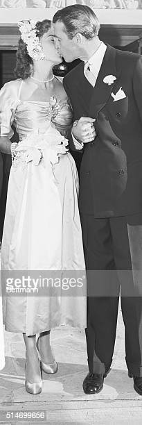 James Stewart kisses Gloria Hatrick McLean after their marriage at the Brentwood Presbyterian Church They remained married for the rest of their...