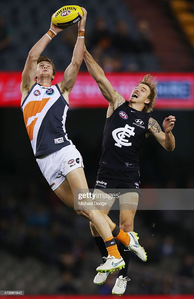 James Stewart marks the ball against Dennis Armfield of the Blues during the round seven AFL match between the Carlton Blues and the Greater Western Sydney Giants at Etihad Stadium on May 16, 2015 in Melbourne, Australia.