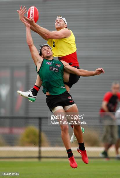 James Stewart of the Bombers attempts to mark over Mark Baguley of the Bombers during the Essendon Bombers training session at The Hangar on January...