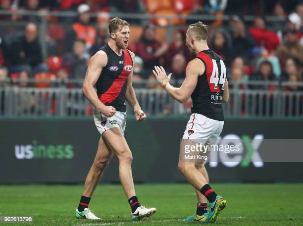 James Stewart of the Bombers celebrates with Shaun McKernan of the Bombers after kicking a goal during the round 10 AFL match between the Greater...