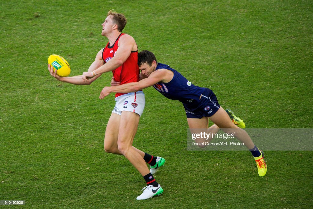 James Stewart of the Bombers is tackled by Hayden Ballantyne of the Dockers during the 2018 AFL round 02 match between the Fremantle Dockers and the Essendon Bombers at Optus Stadium on March 31, 2018 in Perth, Australia.
