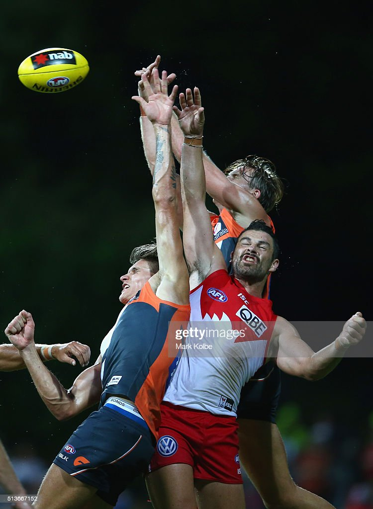 James Stewart of the Giants, Rory Lobb of the Giants and Heath Grundy of the Swans compete for the ball during the 2016 AFL NAB Challenge match between the Sydney Swans and the Greater Western Sydney Giants at Drummoyne Oval on March 4, 2016 in Sydney, Australia.