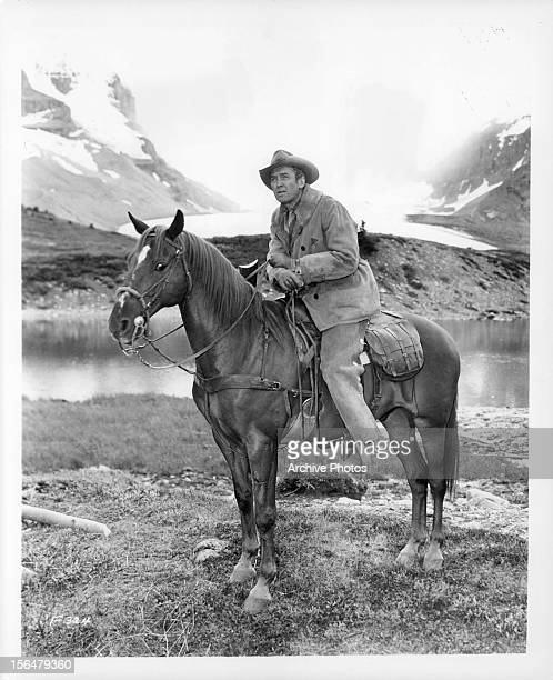 James Stewart sits on a horse in a scene from the film 'The Far Country' 1954