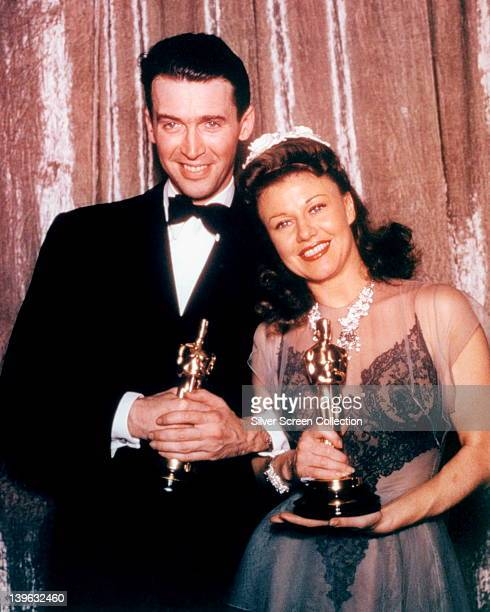 James Stewart US actor wearing a black tuxedo a white shirt and black bow tie with Ginger Rogers US actress and dancer wearing an evening gown both...