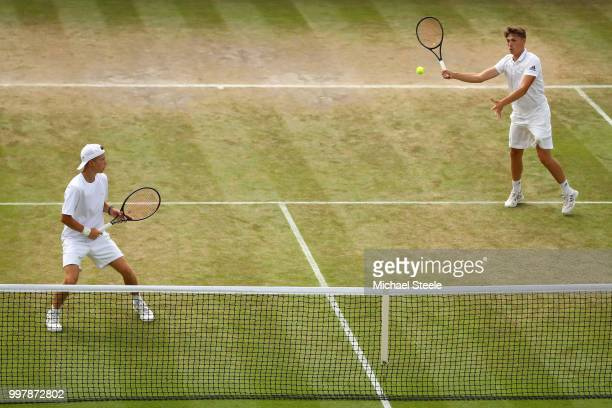James Story and Harry Wendelken of Great Britain return against Aidan McHugh of Great Britain and Timofei Skatov of Kazakhstan during their Boys'...