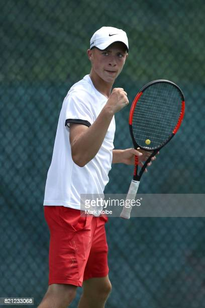 James Story of Wales celebrates as he competes in the Boy's Singles gold medal tennis match between James Story of Wales and Hamish Stewart of...