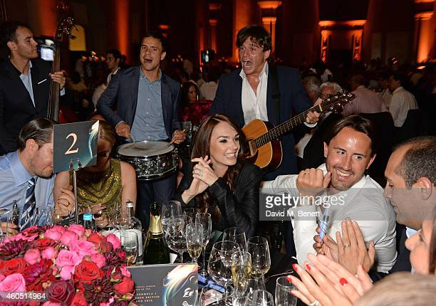 James Stunt Petra Stunt Tamara Ecclestone and Jay Rutland listen to Didier Casnati and The Gypsy Queens at The F1 Party in aid of the Great Ormond...