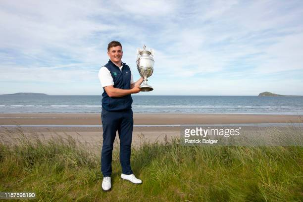 James Sugrue from Ireland celebrates with the Amateur Championship trophy after victory at Portmarnock Golf Club on June 22 2019 in Portmarnock...