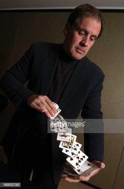 SWAIN 03/30/05 James Swain author of Mr Lucky is a dab hand with card tricks This one is known as 'the accordion'