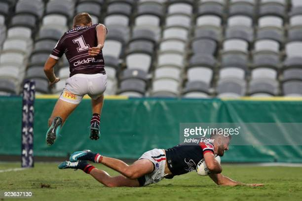 James Tadesco of the Roosters scores a try during the NRL Trial match between the Manly Sea Eagles and the Sydney Roosters at Central Coast Stadium...