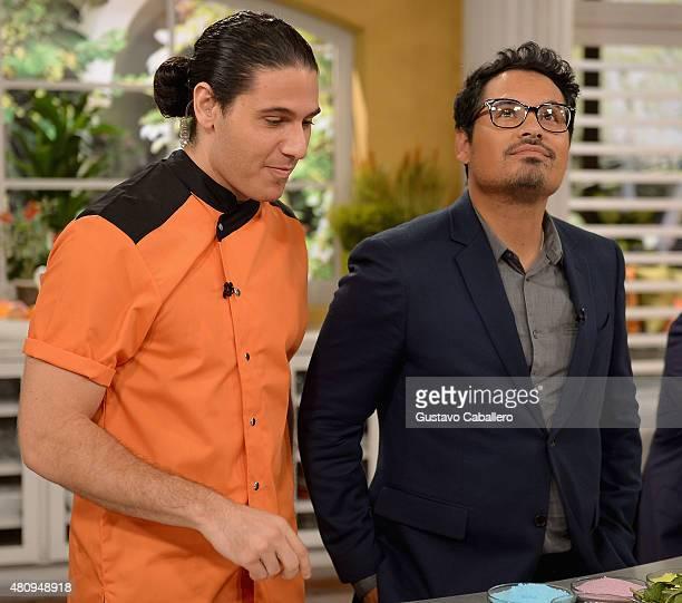 James Tahhan and Michael Pena on the set of Uno Nuevo Dia to promote AntMan at Telemundo Studio on July 16 2015 in Miami Florida