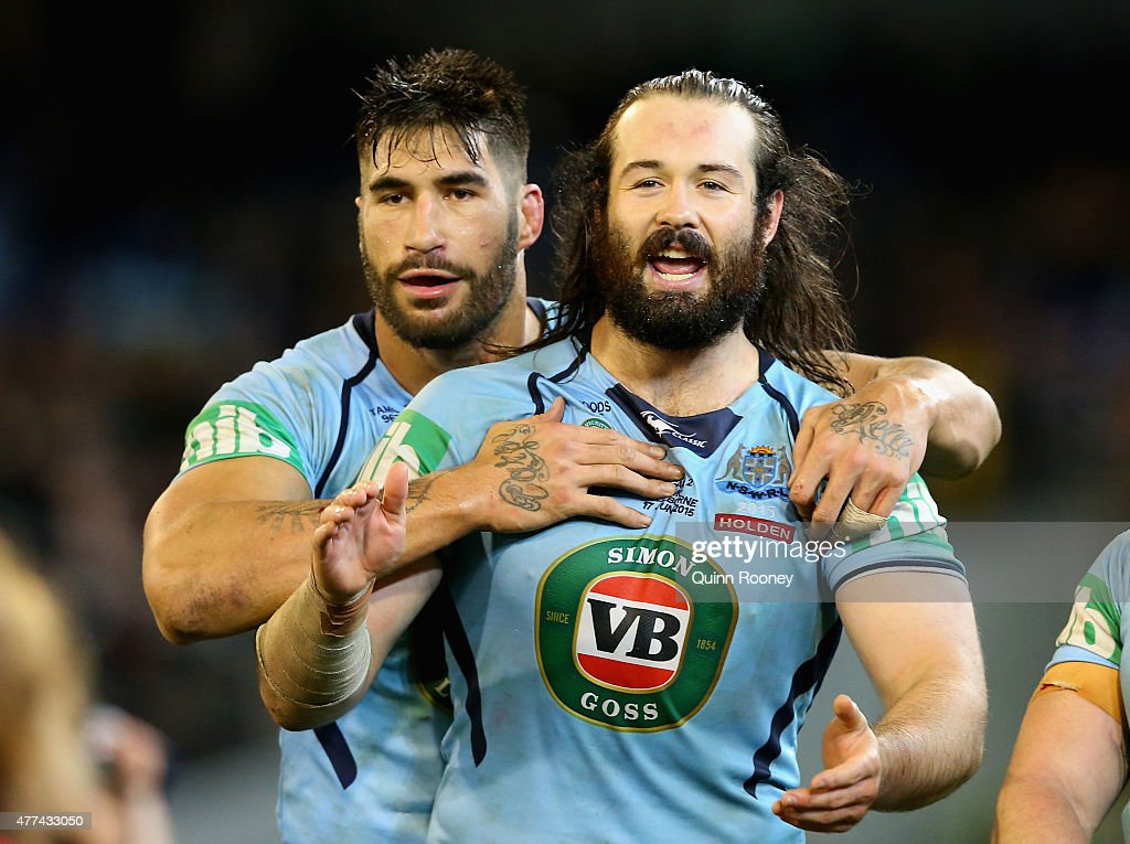 James Tamou and Aaron Woods of the Blues celebrate winning game two of the State of Origin series between the New South Wales Blues and the Queensland Maroons at the Melbourne Cricket Ground on June 17, 2015 in Melbourne, Australia.