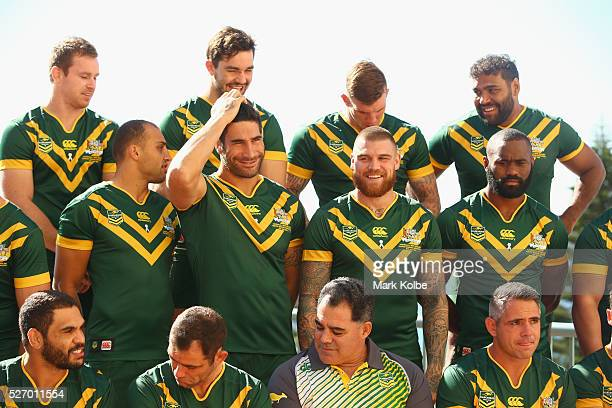 James Tamou fixes his hair as he and his team mates prepare for the team photo during the Australia Kangaroos Test team photo session at Crowne Plaza...