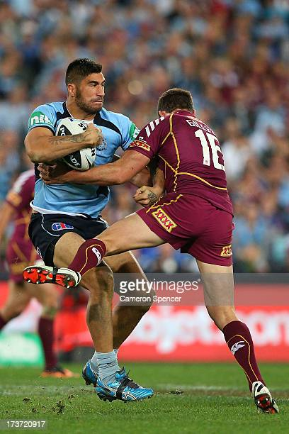 James Tamou of the Blues is tackled during game three of the ARL State of Origin series between the New South Wales Blues and the Queensland Maroons...
