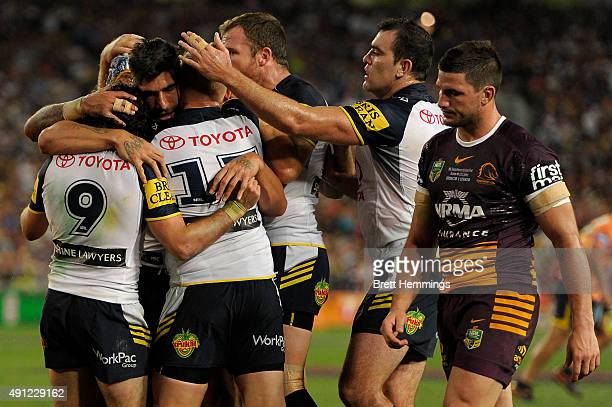 James Tamou of the Cowboys celebrates scoring a try with team mates during the 2015 NRL Grand Final match between the Brisbane Broncos and the North...