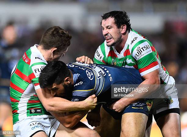 James Tamou of the Cowboys is tackled by David Tyrell of the Rabbitohs  during the round