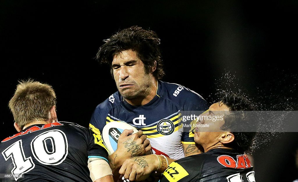 James Tamou of the Cowboys is tackled by Jeremy Latimore and Sika Manu of the Panthers during the round five NRL match between the Penrith Panthers and the North Queensland Cowboys at Pepper Stadium on April 6, 2015 in Sydney, Australia.